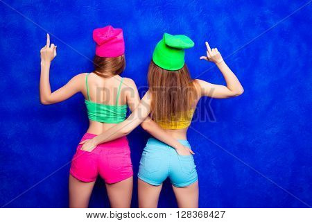 Back View Of Trendy Women Showing Midle Finger