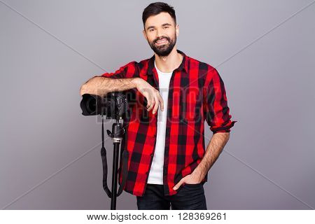 Young Smiling Photographer In Red Shirt With Professional Camera