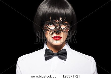 Sexy woman in wig and mask isolated on black
