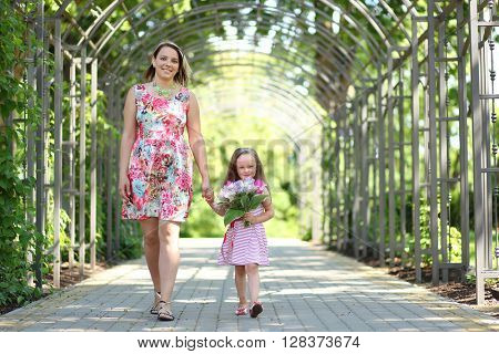 young mother with daughter in park