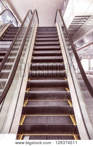 Up And Down Escalators In Public Building