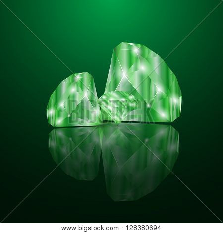Brilliant emeralds. Emeralds on the velvet green background with a reflective surface.