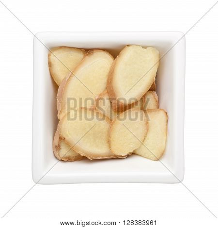 Sliced ginger in a square bowl isolated on white background