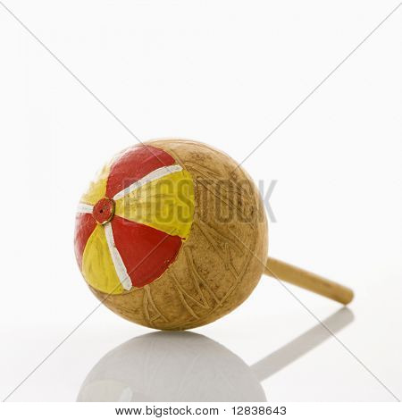Handmade Mexican maraca percussion musical instrument against white background.