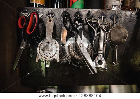 Set of barman equipment hanging on working place