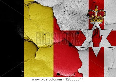 flags of Belgium and Northern Ireland painted on cracked wall