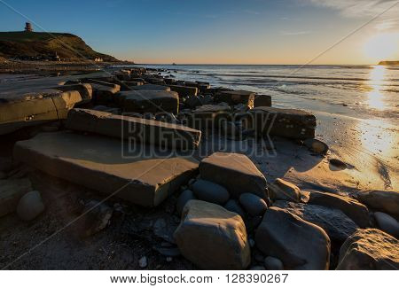 Clavell Tower at Kimmeridge Bay at sunset in Dorset