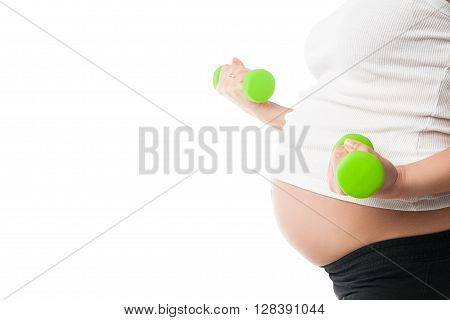Sportive pregnant girl lifting dumbbells isolated on white background, workout indoors, sport for expectant female, healthy pregnancy concept