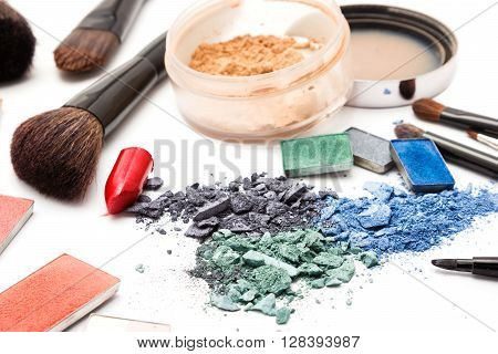 Professional makeup cosmetics. Eyeshadow, lipstick, jar of loose cosmetic powder, blush with brushes