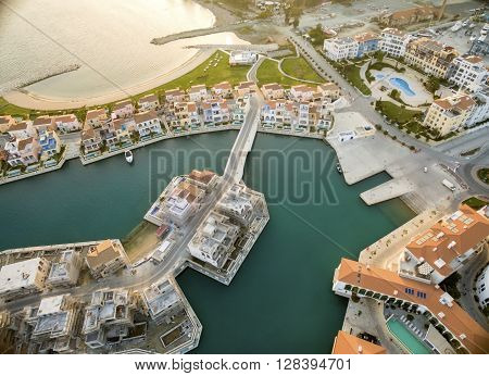 Aerial view of the residential area of the beautiful Marina in Limassol city in Cyprus the beach and villas. A very modern high end and newly developed space where yachts are moored and it's perfect for a waterfront promenade.