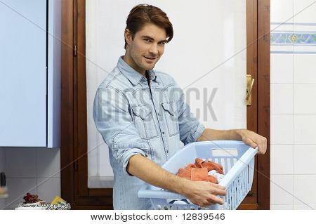 Man Doing Chores And Washing Clothes