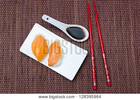 Nigiri with salmon on a placemat bamboo seen from above