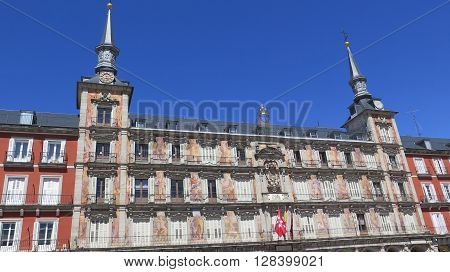 Madrid Spain - April 8 2016: Building with spires and murals in Plaza Mayor in Madrid. Madrid Spain - April 8 2016