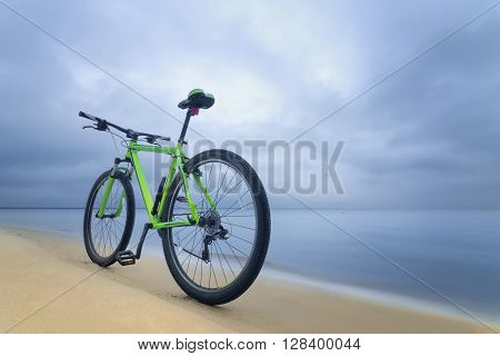 Bike on the bank of the beach, early spring
