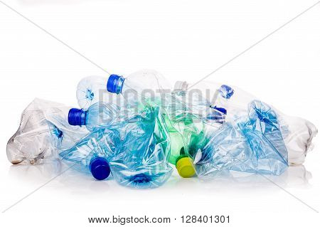 Mineral Water Bottles Crushed And Crumpled Against White Background