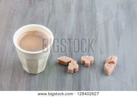 a cup of espresso coffee on a wooden background
