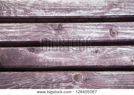 wooden panel with dark brown boards closeup