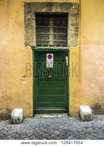 front view of a vintage doorway in Rome italy