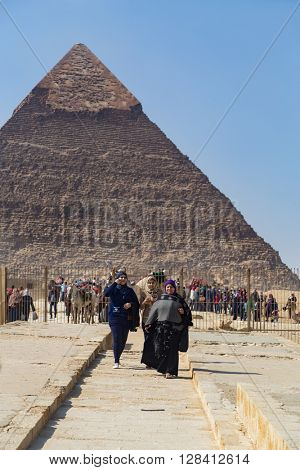 CAIRO, EGYPT - FEBRUARY 3, 2016: Group of tourists around the Great pyramid of Giza.