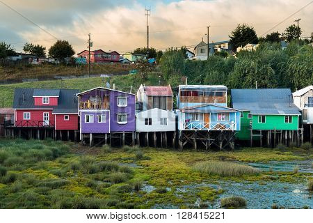 CASTRO - JANUARY 24 2016: The colorful stilts house know as Palafitos are a mayor landmark in the Chiloe Island. Lately these have been renovated. This Photo was taken at the Palafito Pedro Montt on January 24, 2016 in Castro, Chile