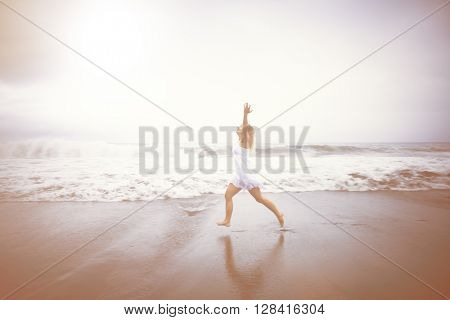 Casual Woman Celebrating Life by the Beach