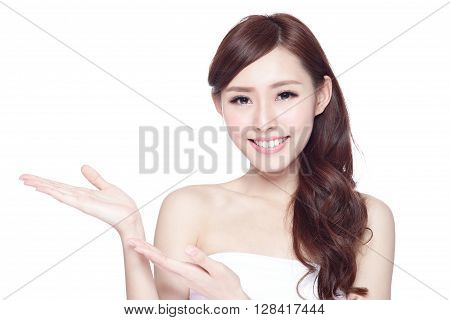 Beauty woman show something to you with charming smile health skin teeth and hair isolated on white background asian beauty