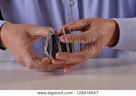 Man hands shuffling game cards