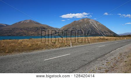 Nature background. Landscape in New Zealand. Ben Ohau Range and road.