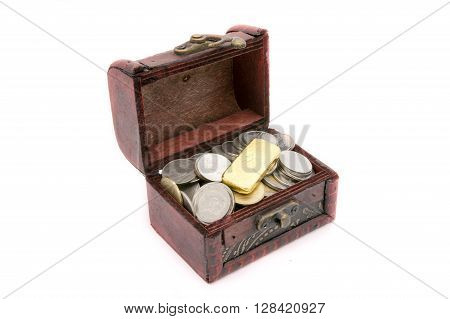 Old wooden chest with golden coins on white background
