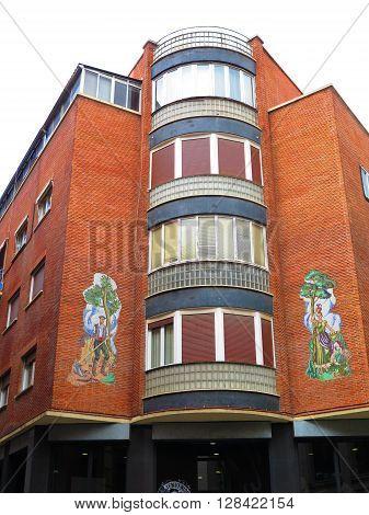 Madrid Spain - April 11 2016:  Madrid Corner Building with two large murals. Madrid Spain - April 11 2016