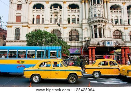 KOLKATA, INDIA - JAN 22, 2013: Colorful taxi cabs drive faster of real speed limit on the busy street of city on January 22, 2013 in Calcutta. Kolkata has a density of 814.80 vehicles per km road length