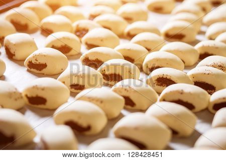 Production of sweet buns at the factory. Enterprise for the production of bread. Buns with poppy seeds ready for baking. Desserts on the shelves. ** Note: Soft Focus at 100%, best at smaller sizes
