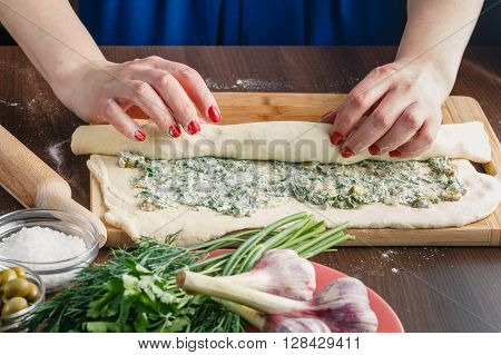 preparing Stuffed French Bread with olives and herbs
