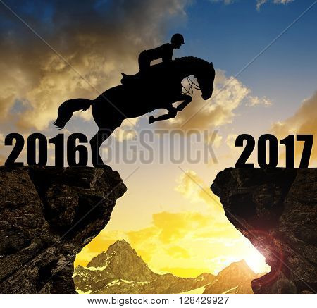 The rider on the horse jumping into the New Year 2017