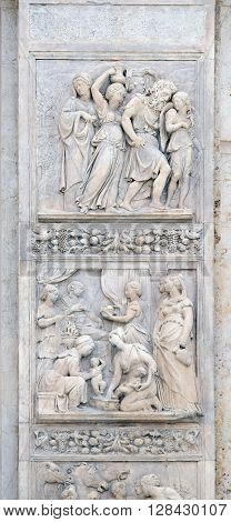 BOLOGNA, ITALY - JUNE 04: Escape of Loth by Niccolo Tribolo up and Birth of Esau and Jacob by Alfonso Lombardi down, left door of San Petronio Basilica in Bologna, Italy, on June 04, 2015