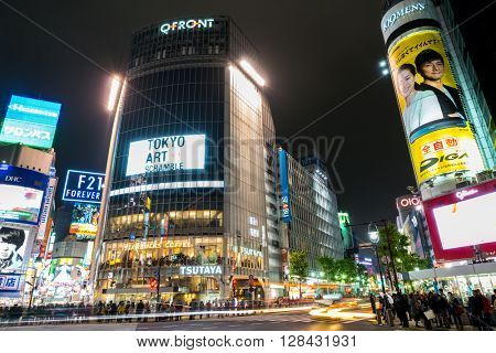 Tokyo, Japan - Nov 25: Pedestrians cross at Shibuya Crossing on November 25 th in Tokyo, Japan, 2015 . Shibuya Crossing is one of the busiest crosswalks in the world.