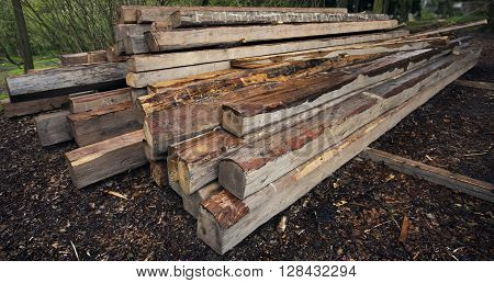 Wooden beams. Perspective composition with long beams. Exterior scene with building material. Roof building wooden components. Carpentery beam.