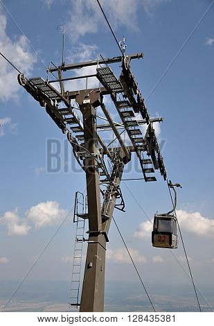 look for modern cableway  in the mountains by day