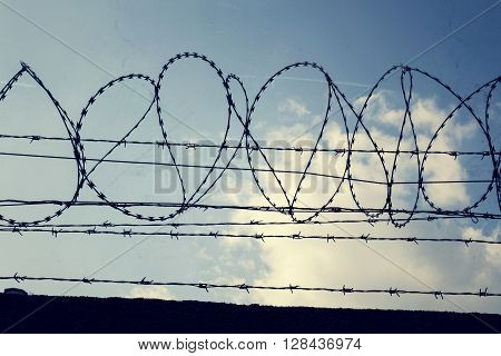 Filtered Vintage Picture Of Barbed Wire Fence Detail