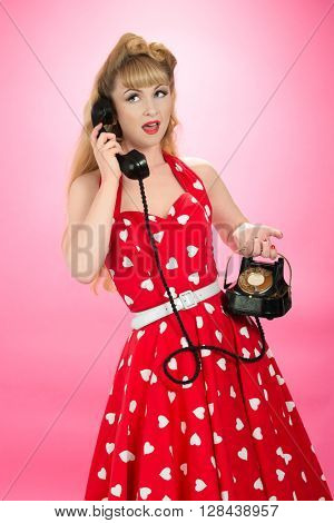 Pin up girl with vintage telephone
