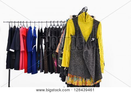 Set of different clothes for females on hanging