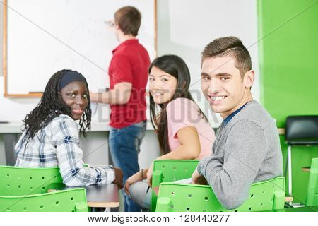 Interracial group of students in a math presentation at school