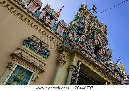 Intricate carvings of hindu deities over entrance of oldest Hindu temple in Malaysia, Sri Mahamariamman Temple, Little India in historic George Town, Penang.