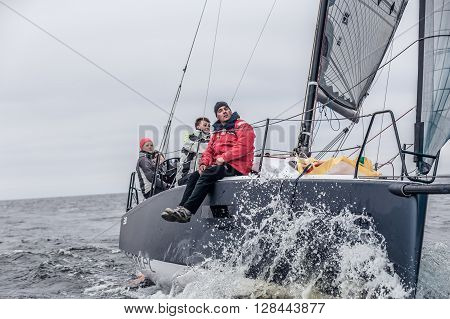 KYIV, UKRAINE - APRIL 26 2016: Traning on the new model of yacht OceanTECH L30 on the Kyiv water reservoir or Kyiv SEA with Rodion Luka, L30 idea author, Silver Olympic medalist.