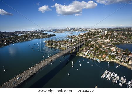 Aerial view of Victoria Road bridge and boats in Sydney, Australia.