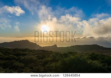 Sundown in the highlands of La Gomera. View direction Valle Gran Rey. Clouds from trade winds over the mountains on La Gomera. The clouds comes from the Azores in circa 800m altitude