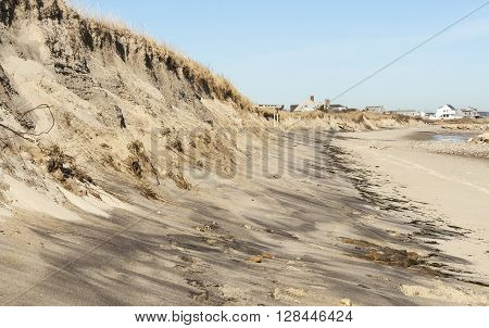 Dunes along shoreline of Cape Cod Bay chopped off by tides