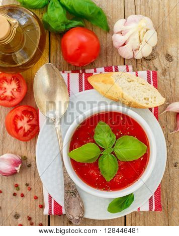 Tomato Gazpacho - cold soup of pureed raw vegetables - tomatoes cucumbers peppers garlic and spices with olive oil. Dish of Spanish cuisine. The Mediterranean diet
