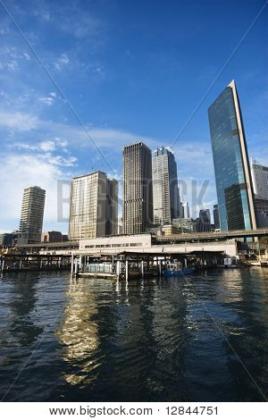 Circular Quay Railway Station in Sydney Cove with view of downtown skyscrapers in Sydney, Australia.