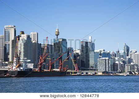 Downtown Sydney, Australia with view of cargo ship and harbour.